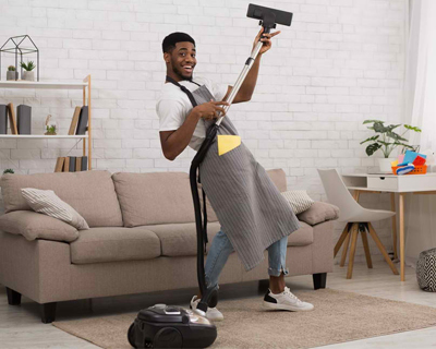 a man cleaning the living room