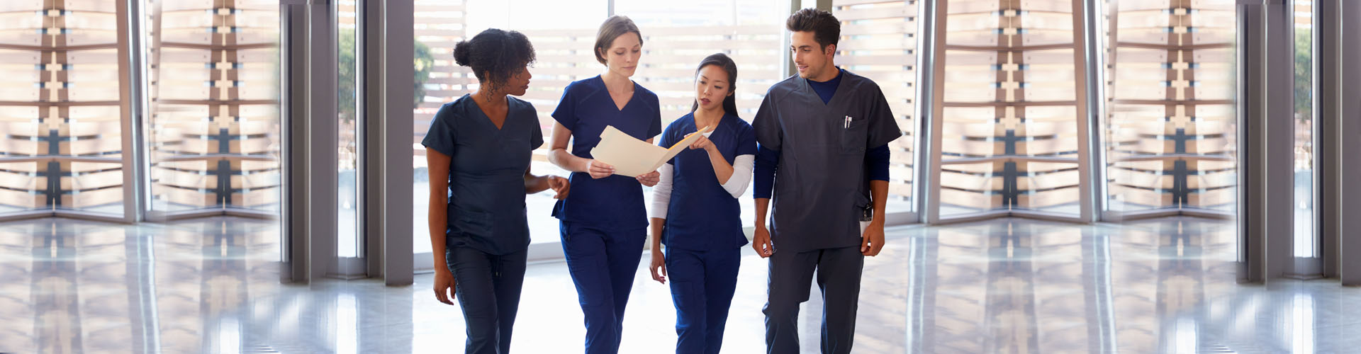 a group of caregivers discussing while walking
